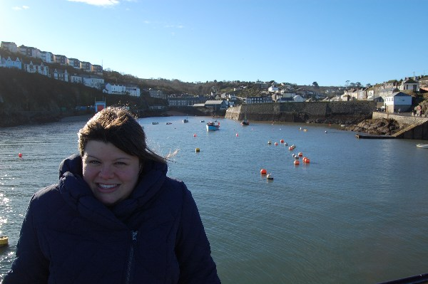 Alexa in front of Mevagissey harbour in Cornwall.