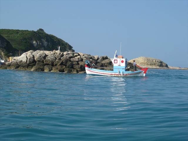 A fishing boat on the sea off the coast of Corfu.