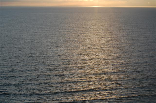 The sea at sunset on Rhossili bay, South Wales.